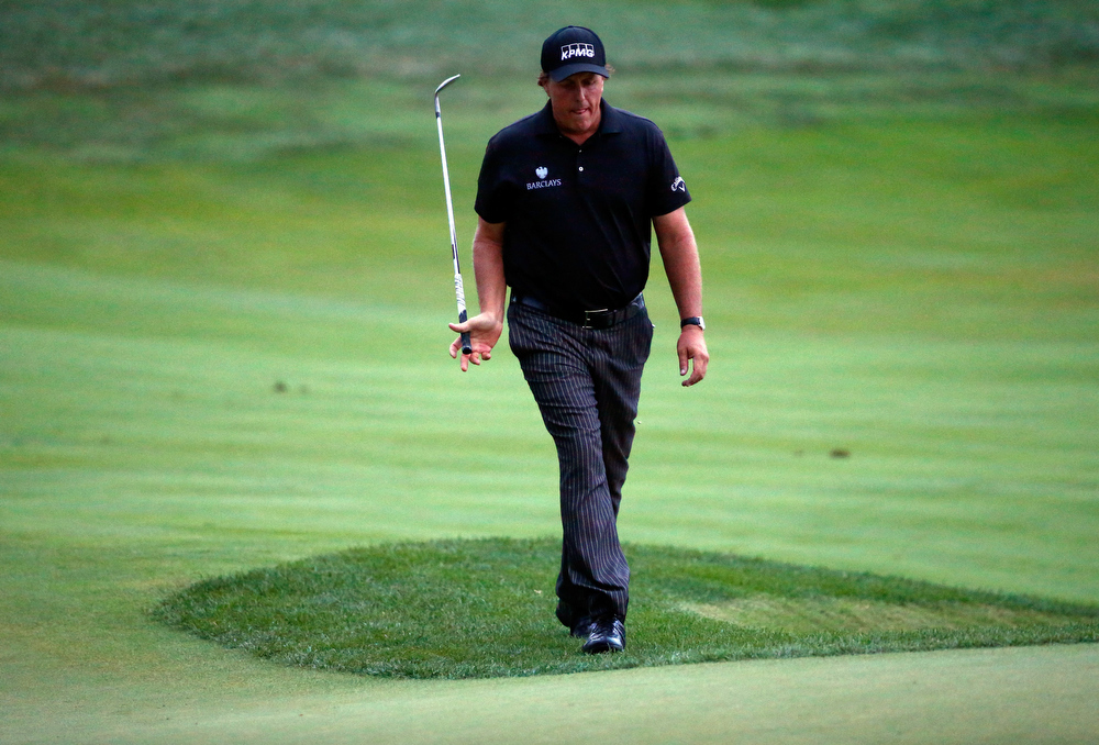 . Phil Mickelson of the United States walks to the 18th green during the final round of the 96th PGA Championship at Valhalla Golf Club on August 10, 2014 in Louisville, Kentucky.  (Photo by Sam Greenwood/Getty Images)