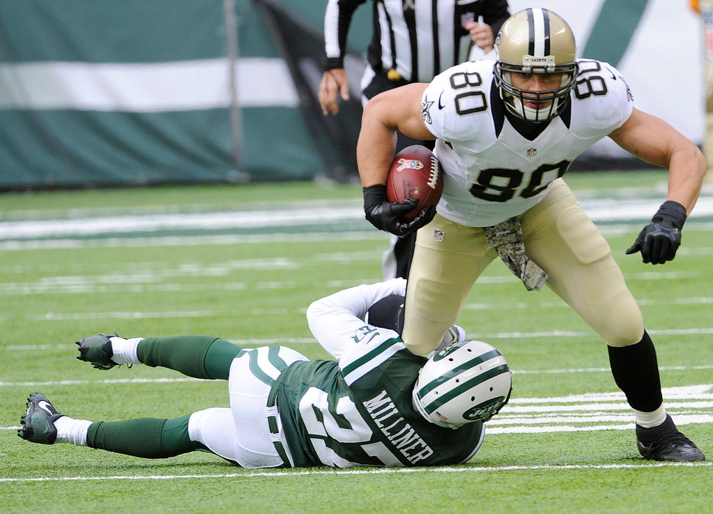 . New Orleans Saints tight end Jimmy Graham (80) is tackled by New York Jets\' Dee Milliner (27) during the first half of an NFL football game Sunday, Nov. 3, 2013, in East Rutherford, N.J.  (AP Photo/Bill Kostroun)