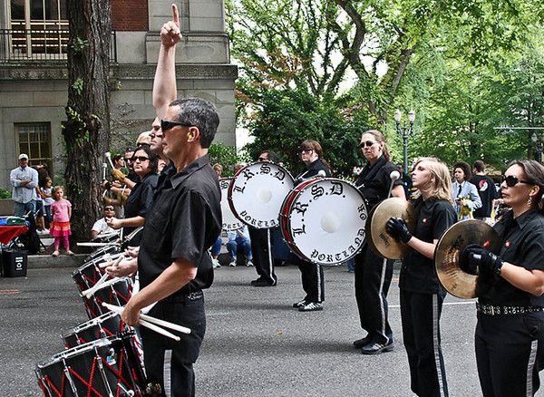 1224 follow the leader  All eyes are on the leader.  You know what the two women in the back row are watching?  Yep ... cymbal symbol.  ;-)
