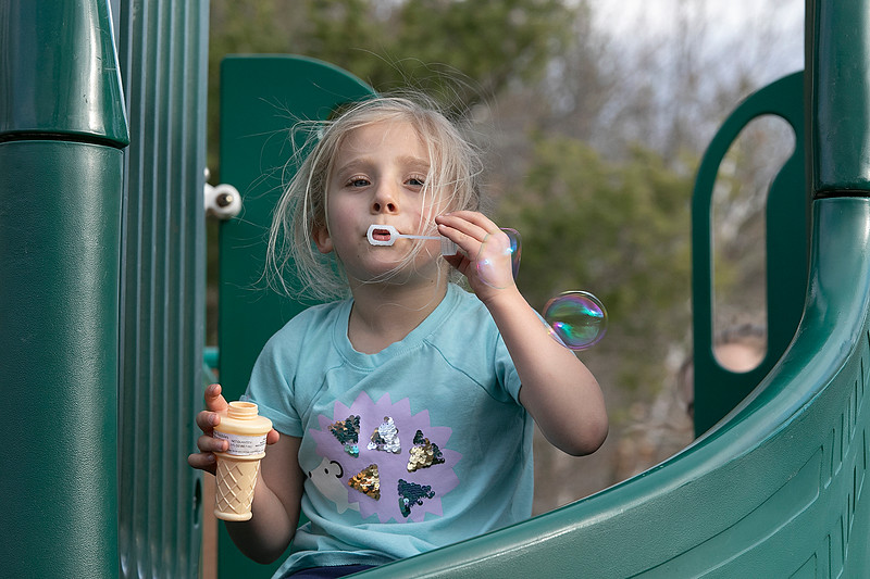 The good weather on Tuesday, March 10, 2020 brought many out to have fun at Parkhill Park in Fitchburg. Lillian Dimarzio, 6, of Fitchburg had fun playing on the playground equipment at the park. Here she blows some bubbles. SENTINEL & ENTERPRISE/JOHN LOVE