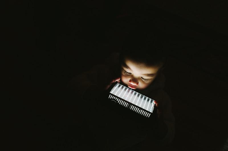 Indigenous Australian Baby holding an LED Video Light