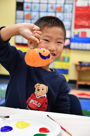 Kindergarten and Eighth-Grade Buddies Paint Pumpkins for The Children's Inn at NIH