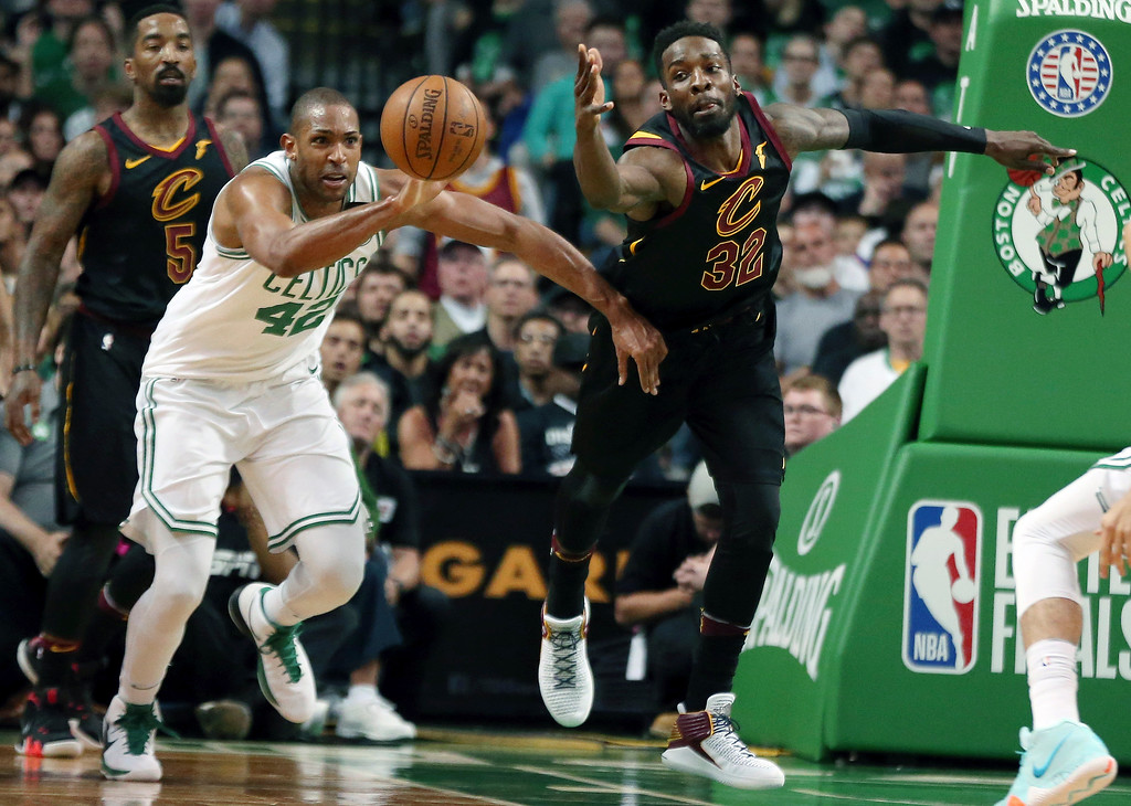 . Boston Celtics forward Al Horford (42) and Cleveland Cavaliers forward Jeff Green (32) chase a loose ball during the first half in Game 7 of the NBA basketball Eastern Conference finals, Sunday, May 27, 2018, in Boston. (AP Photo/Elise Amendola)