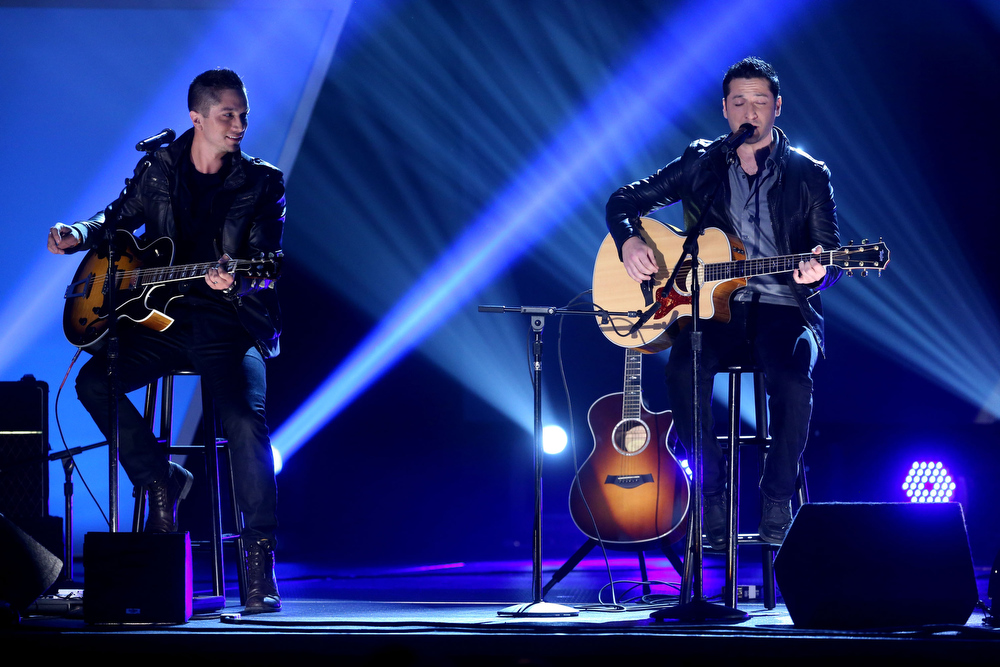 Description of . Music Group Boyce Avenue performs onstage at the 3rd Annual Streamy Awards at Hollywood Palladium on February 17, 2013 in Hollywood, California.  (Photo by Frederick M. Brown/Getty Images)