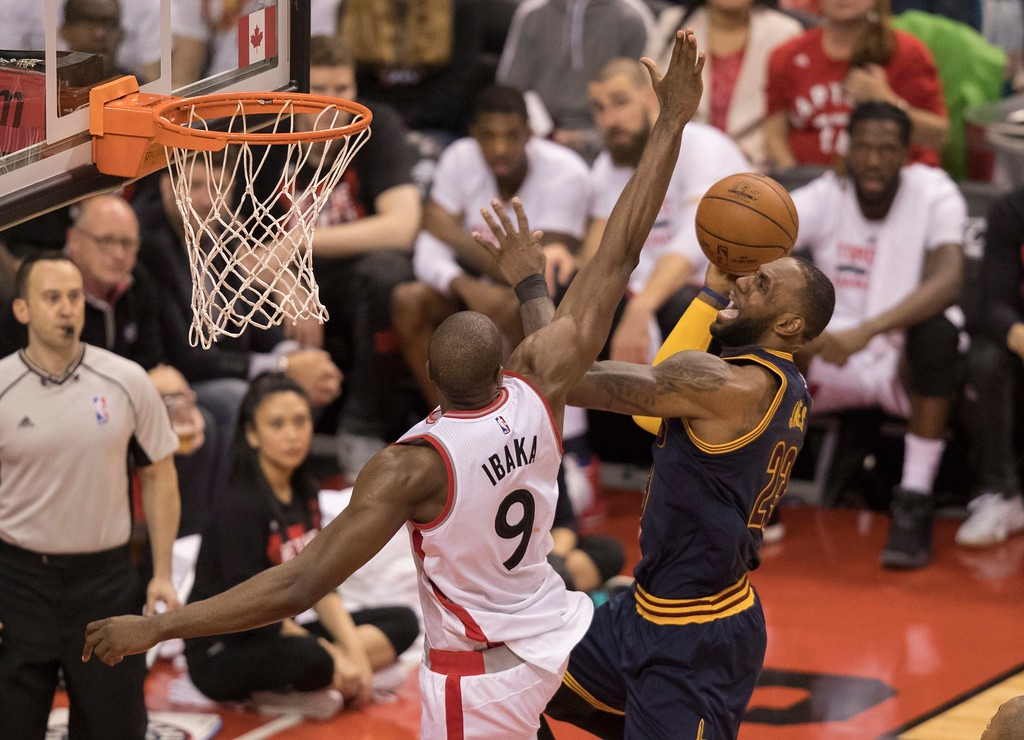 . Cleveland Cavaliers\' LeBron James (23) drives to the basket as Toronto Raptors\' Serge Ibaka defends during the second half of Game 3 of an NBA basketball second-round playoff series in Toronto on Friday, May 5, 2017. (Fred Thornhill/The Canadian Press via AP)