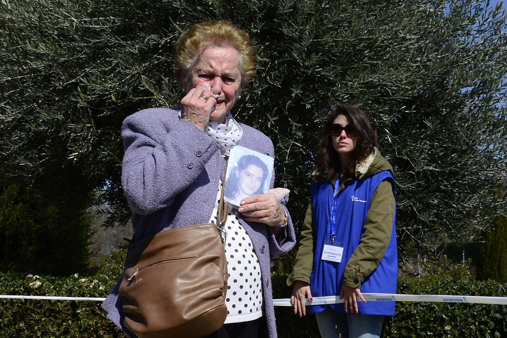 . Antonia Santiago Garcia holds a phot of her late daughter Maria Dolores Duran Santiago, who died multiple terror attacks, during a commemoration ceremony in held in the Rememberance Garden of Madrid\'s Retiro Park on March 11, 2014 for the victims of the Madrid train bombings marking the10th year anniversary of the attacks that claimed 191 lives and injured more than 1800 others. On March 11, 2004 at 7:40 am, 10 bombs exploded on board four packed commuter trains in Madrid in an attack claimed by the Al-Qaeda terror network, which said they were punishment for Spain\'s role in the US-led invasion of Iraq.   JAVIER SORIANO/AFP/Getty Images