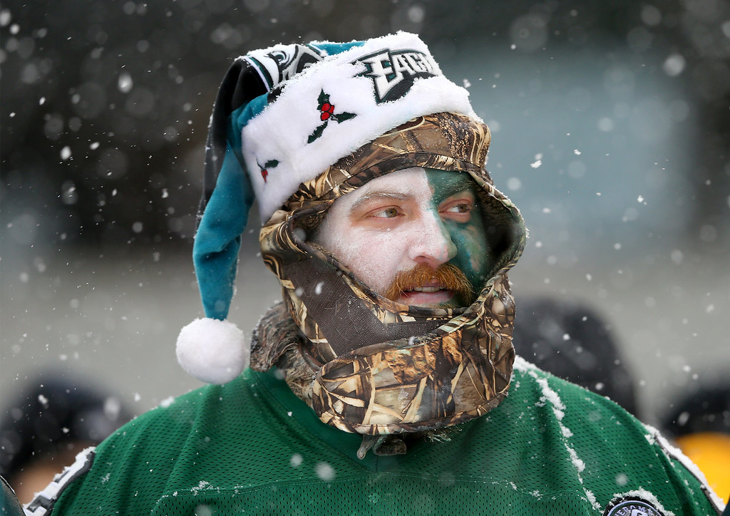 . A Philadelphia Eagles fan watches the game in the third quarter against the Detroit Lions on December 8, 2013 at Lincoln Financial Field in Philadelphia, Pennslyvania.  (Photo by Elsa/Getty Images)