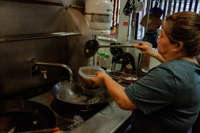 Photo Story. Yesun Som, The true backbone of the restaurant. She is the one behind closed doors cooking the food all of the people love. after being in Thailand for six long months she expresses that she is happy to be home and cooking again around all of the people she loves.