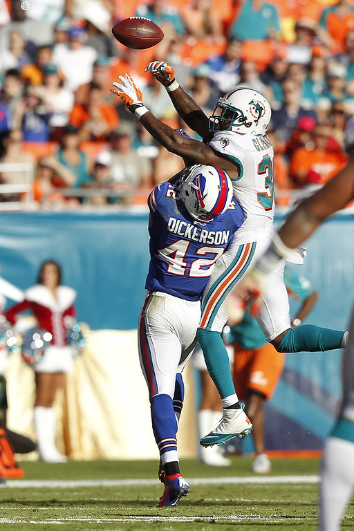 . Chris Clemons #30 of the Miami Dolphins defends against Dorin Dickerson #42 of the Buffalo Bills on December 23, 2012 at Sun Life Stadium in Miami Gardens, Florida. The Dolphins defeated the Bills 24-10. (Photo by Joel Auerbach/Getty Images)