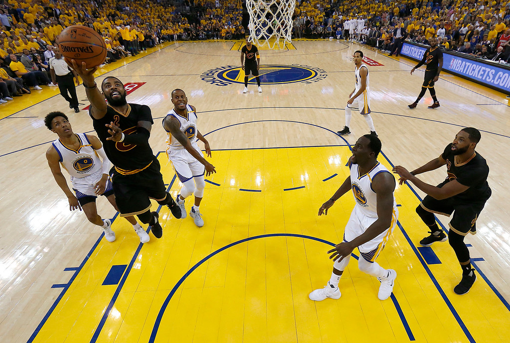 . Cleveland Cavaliers guard Kyrie Irving, left, shoots against the Golden State Warriors during the first half of Game 5 of basketball\'s NBA Finals in Oakland, Calif., Monday, June 12, 2017. (AP Photo/Marcio Jose Sanchez, Pool)