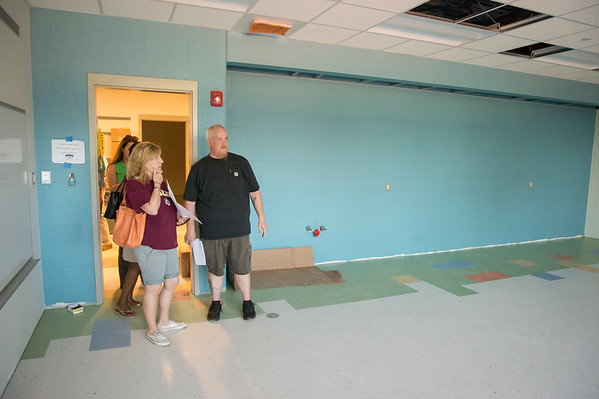 06/12/19 Wesley Bunnell | Staff Smaley School second grade teacher Robin Pizzuto stands with custodian Tim Westerman in a classroom under construction during a walk through by teachers and administrators on June 12, 2019. The walk through allowed teachers and administrators their first glimpse of the renovations and additions which are scheduled for completion in August.