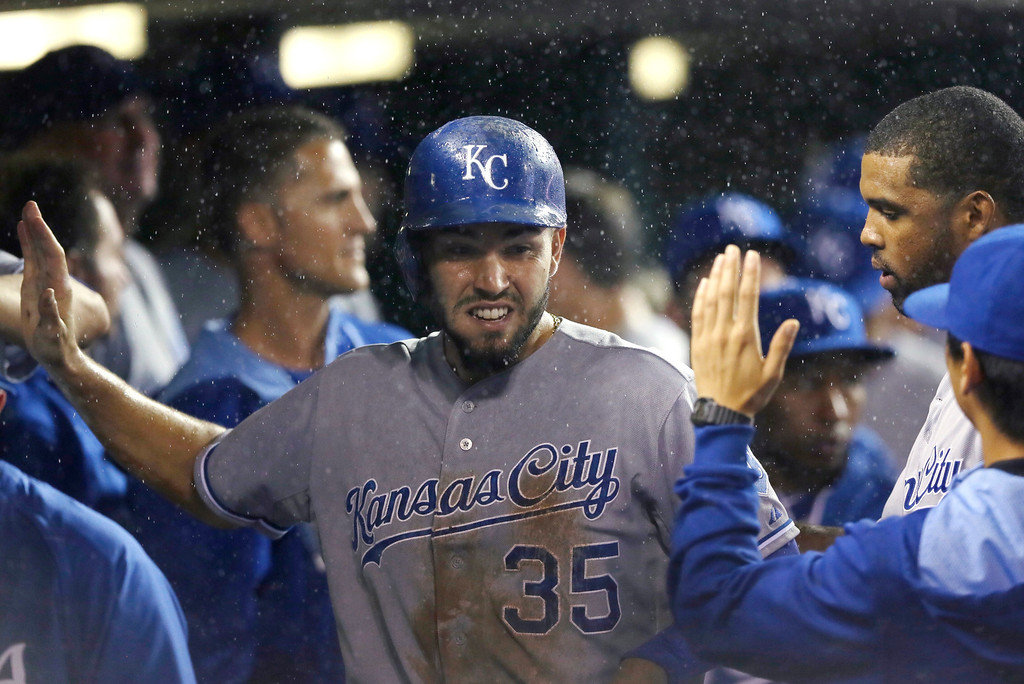 . Kansas City Royals\' Eric Hosmer is greeted in the dugout after scoring from third on a single by teammate Lorenzo Cain during the fourth inning of a baseball game against the Detroit Tigers in Detroit, Wednesday, Sept. 10, 2014. (AP Photo/Carlos Osorio)