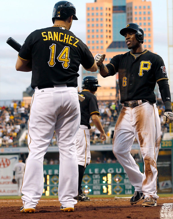 . Pittsburgh Pirates\' Starling Marte (6) is greeted by on deck batter Gaby Sanchez after scoring from third on a double by Andrew McCutchen in the third inning of the baseball game against the Colorado Rockies on Saturday, Aug. 3, 2013, in Pittsburgh. (AP Photo/Keith Srakocic)