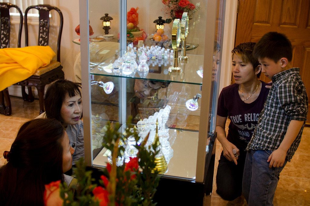 . A small group of people look at the different relics on display at Lu Mountain Temple in Rosemead, Calif., Sunday, March 31, 2013. Several shariras were made available for viewing to the public including a rare Shakyamuni Buddha tooth relic measuring about two inches in height. (SGVN/Correspondent photo by Anibal Ortiz)