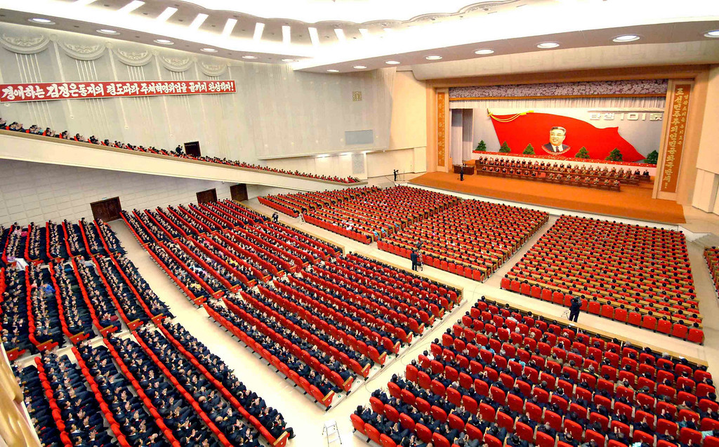 . Attendees applaud during a central report meeting to celebrate the 101st birth anniversary of North Korean founder Kim Il-Sung, at the April 25 Culture Hall in Pyongyang, in this photo distributed by North Korea\'s Korean Central News Agency (KCNA) on April 14, 2013.