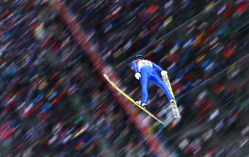 . Bernhard Gruber of Austria competes in the Nordic Combined Men\'s Individual LH during day 11 of the Sochi 2014 Winter Olympics at RusSki Gorki Jumping Center on February 18, 2014 in Sochi, Russia.  (Photo by Clive Mason/Getty Images)