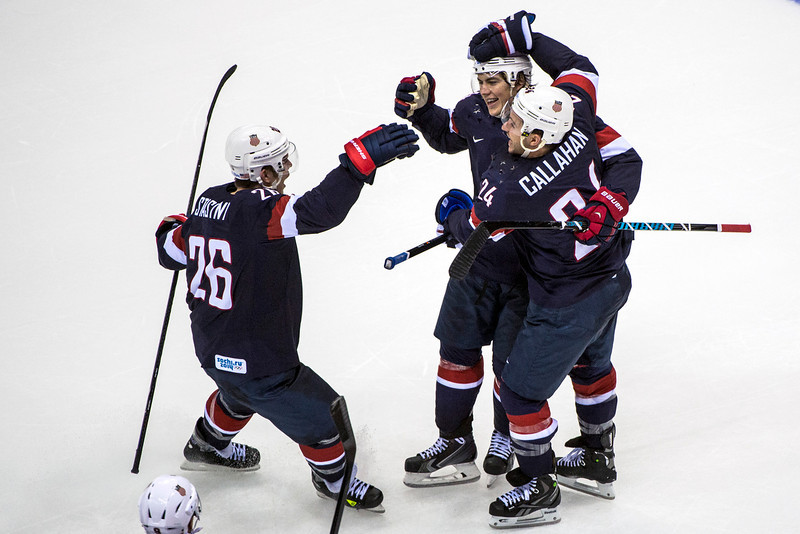 . United States\' T.J. Oshie celebrates with his teammates Paul Stastny (26) and Ryan Callahan (24) after winning the game in an overtime shootout against Russia at Bolshoy Ice Dome during the 2014 Sochi Olympics Saturday February 15, 2014. The United States men\'s hockey team defeated Russia with a 3-2 overtime victory. (Photo by Chris Detrick/The Salt Lake Tribune)