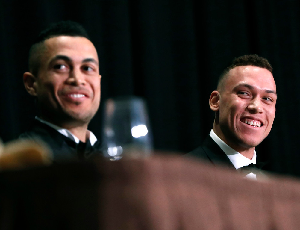 . National League Most Valuable Player Giancarlo Stanton, left, and American League Rookie of the Year Aaron Judge sit side-by-side during the New York Chapter of the Baseball Writers\' Association of America annual dinner in New York, Sunday, Jan. 28, 2018, where both men picked up their awards. Stanton, who signed with the New York Yankees in the off-season, joins Judge to form a powerful Yankees lineup. (AP Photo/Kathy Willens)