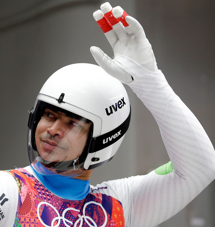 . Shiva Keshavan, who if from India but is competing under the Olympics flag, waves to supporters in the finish area during the men\'s singles luge final at the 2014 Winter Olympics, Sunday, Feb. 9, 2014, in Krasnaya Polyana, Russia. (AP Photo/Natacha Pisarenko)