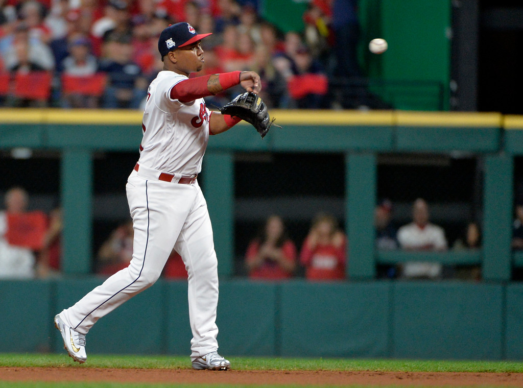 . Cleveland Indians\' Jose Ramirez throws out New York Yankees\' Didi Gregorius in the first inning of Game 1 of baseball\'s American League Division Series, Thursday, Oct. 5, 2017, in Cleveland. (AP Photo/Phil Long)