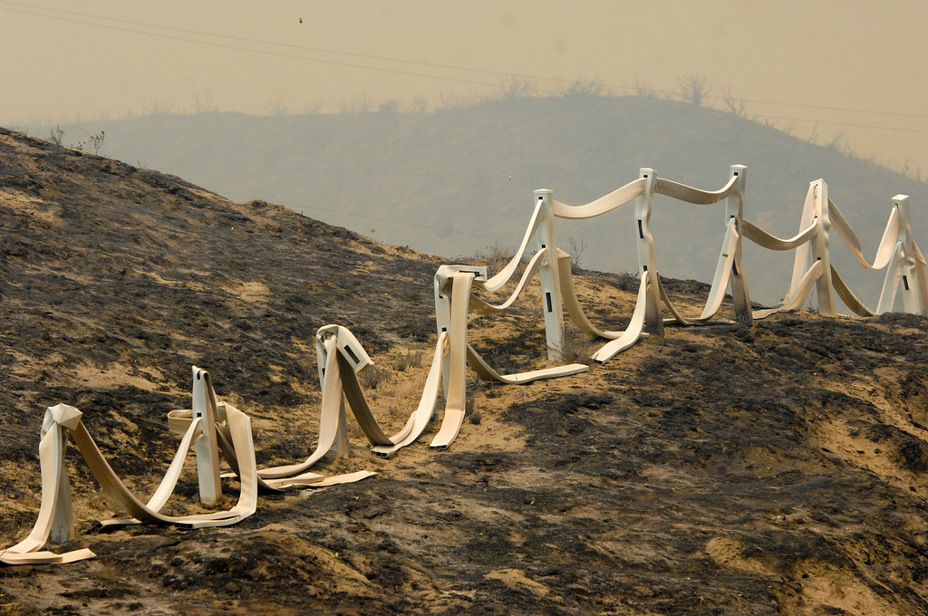 . Melted fences on Elizabeth Lake Road from the Powerhouse Fire, Sunday, June 2, 2013. (Michael Owen Baker/Staff Photographer)