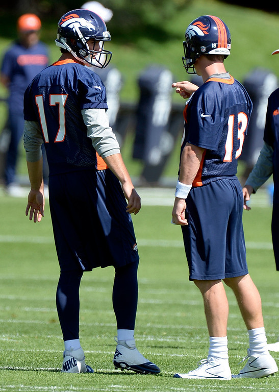 . Brock Osweiler (17) of the Denver Broncos chats with Peyton Manning (18)  during the teams OTAs May 20, 2013 at Dove Valley. All offseason training activities (OTAs) are voluntary until the mandatory minicamp June 11-13. (Photo By John Leyba/The Denver Post)