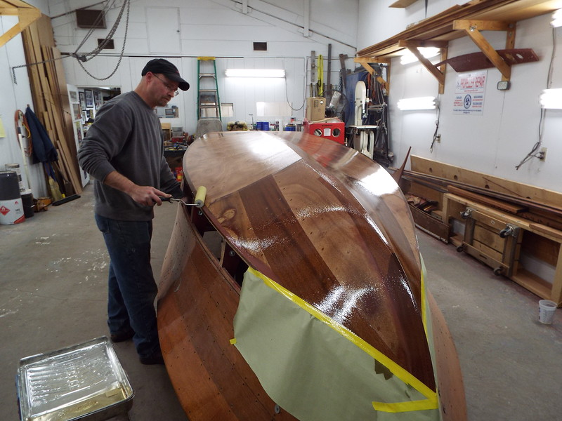 Appling the third coat of epoxy.