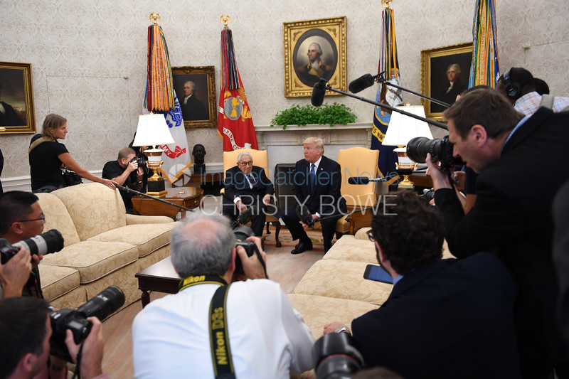 President Donald Trump welcomes former Secretary of State Henry Kissinger to the Oval Office.