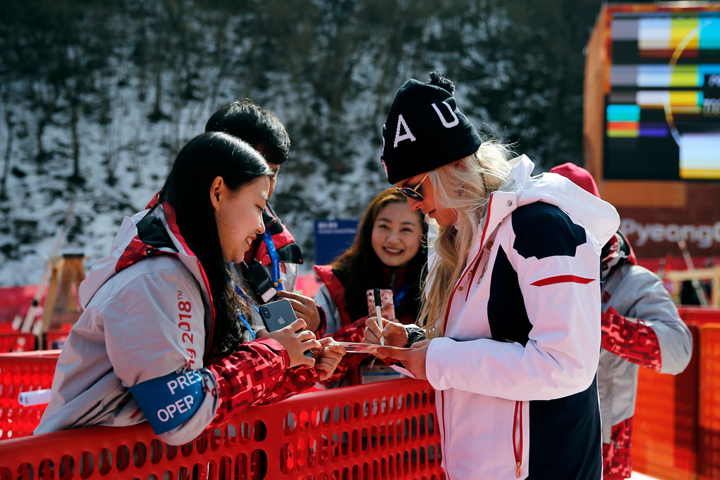 . Lindsey Vonn, of the United States, signs autographs for volunteers after skiing at a ladies\' downhill training session during the 2018 Winter Olympics in Jeongseon, South Korea, Sunday, Feb. 18, 2018. (AP Photo/Patrick Semansky)