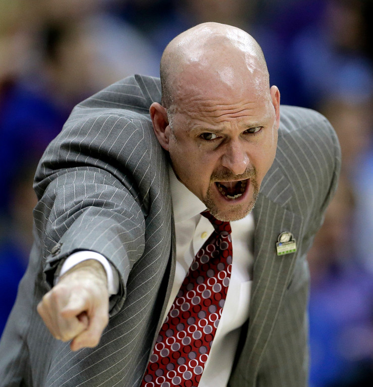 . Mississippi coach Andy Kennedy talks to his players during the second half of their second-round game against Mississippi in the NCAA college basketball tournament Friday, March 22, 2013, in Kansas City, Mo. Mississippi won 57-46. (AP Photo/Charlie Riedel)