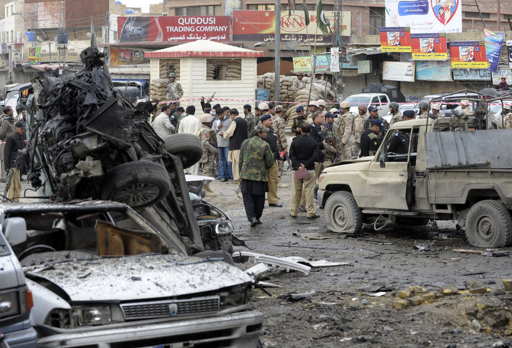 Description of . Pakistani security personnel examine the site of a bomb explosion in Quetta on January 10, 2013. A bomb attack killed 11 people and wounded dozens more in a crowded part of Pakistan's southwestern city of Quetta, police said. AFP PHOTO/Banaras  KHAN/AFP/Getty Images