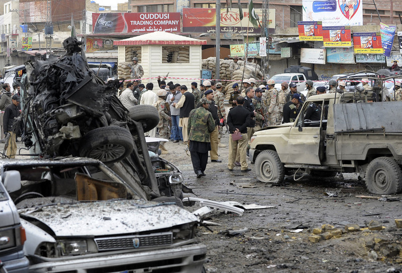 . Pakistani security personnel examine the site of a bomb explosion in Quetta on January 10, 2013. A bomb attack killed 11 people and wounded dozens more in a crowded part of Pakistan\'s southwestern city of Quetta, police said. AFP PHOTO/Banaras  KHAN/AFP/Getty Images