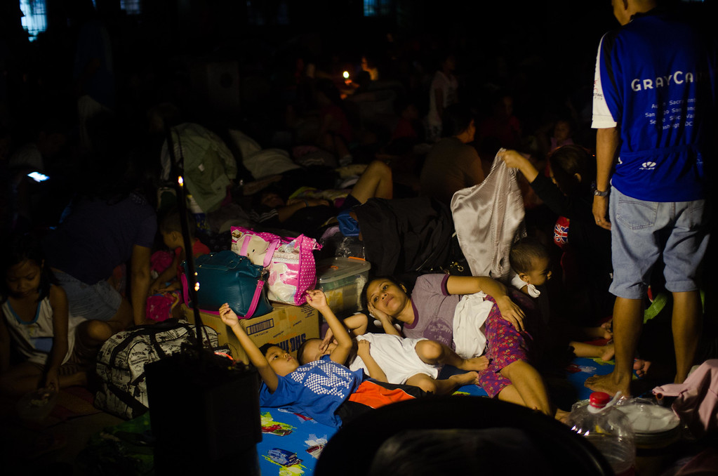 . Affected families take shelter in a gymnasium converted into an evacuation center after continued monsoon rains triggered by tropical storm Fung-Wong inundated parts of Marikina on September 19, 2014 in Manila, Philippines. (Photo by Dondi Tawatao/Getty Images)