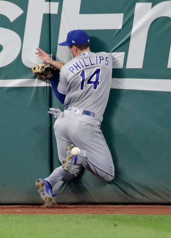 . Kansas City Royals\' Brett Phillips crashes into the wall while chasing an RBI double hit by Cleveland Indians\' Jose Ramirez during the second inning of a baseball game Tuesday, Sept. 4, 2018, in Cleveland. (AP Photo/Tony Dejak)