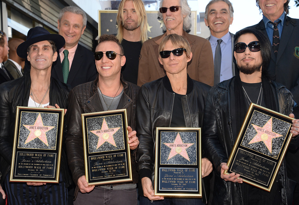 . From left: Perry Farrell, Stephen Perkins, Chris Chaney and Dave Navarro of the alt-rock band Jane\'s Addiction attend the ceremony honoring the band with a star on The Hollywood Walk of Fame, October 30, 2013 in Hollywood, California.           (ROBYN BECK/AFP/Getty Images)