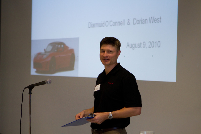 Peter Hasenkamp '98 E'99 E'00, in Tesla's Supply Chain Management, explaining the procedure for drawing names to go on two tours and rides in Tesla's roadsters.