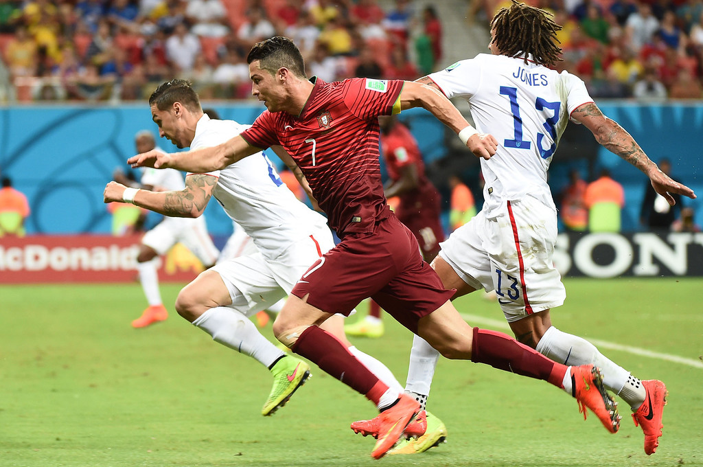 . Portugal\'s forward Cristiano Ronaldo (2nd R) chases the ball during a Group G match between USA and Portugal at the Amazonia Arena in Manaus during the 2014 FIFA World Cup on June 22, 2014.   RAPHAEL ALVES/AFP/Getty Images