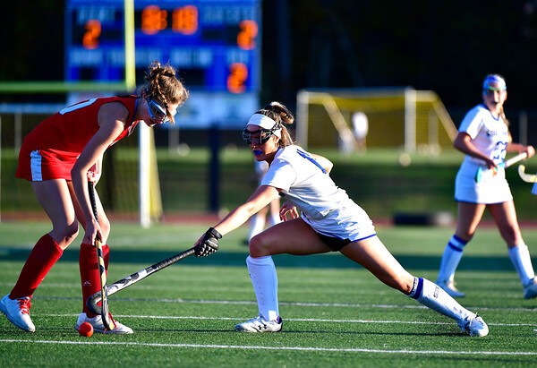10/15/2019 Mike Orazzi | StaffrConard High Schools Sarah Gallagher r(10) and Southington High Schools Jenna Sheehan (11) during a 2-2 tie in field hockey action in Southington on Tuesday afternoon. r
