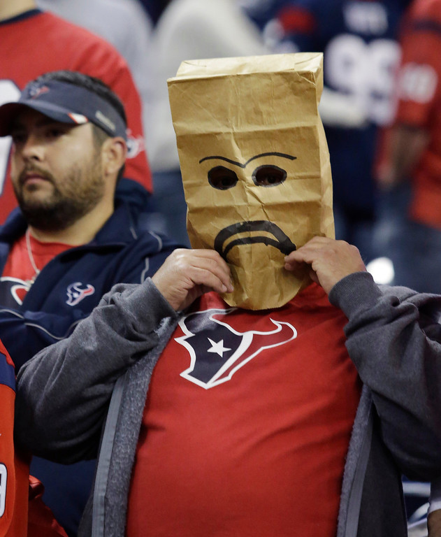 . A fan wears a sack over his head after the Houston Texans lost to the Indianapolis Colts in an NFL football game, Sunday, Nov. 3, 2013, in Houston. Indianapolis won 27-24. (AP Photo/Patric Schneider)