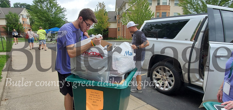 One of 400 volunteers, Andrew Auth, a SRU sophomore, of Pittsburgh helps pack a moving cart Thursday at Slippery Rock University's Move-In Day. Photo by Nathan Bottiger.