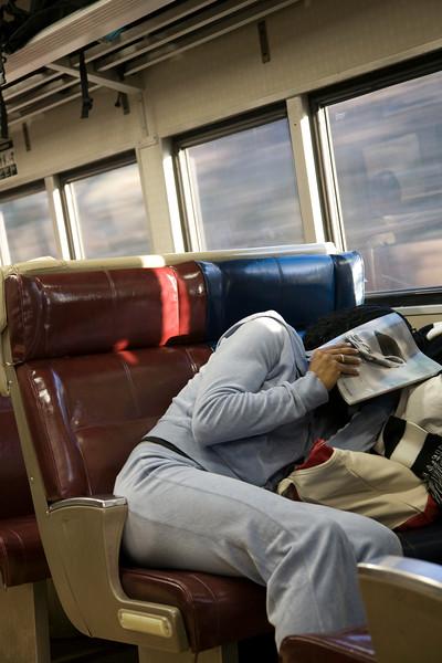 Girl trying to get asleep on a train, NYC, USA