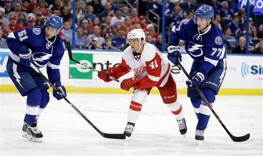. Detroit Red Wings right wing Luke Glendening (41) watches his goal get past Tampa Bay Lightning center Valtteri Filppula (51), of Finland, and defenseman Victor Hedman (77) during the third period of Game 1 of an NHL Eastern Conference playoff hockey series Thursday, April 16, 2015, in Tampa, Fla. (AP Photo/Chris O\'Meara)