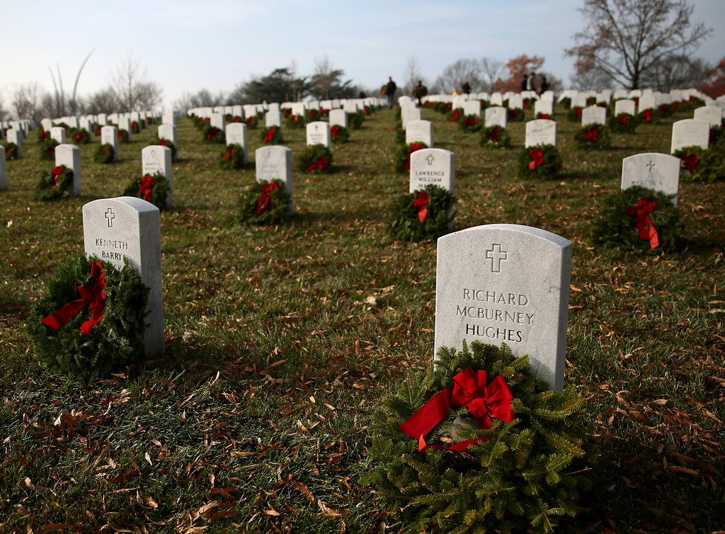 . Wreaths are placed on graves during the National Wreaths Across America Day at Arlington National Cemetery, December 13, 2014 in Arlington, Virginia. Volunteers placed wreaths throughout the entire cemetery in honor of Arlingtons 150th anniversary.  (Photo by Mark Wilson/Getty Images)