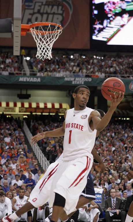 . Ohio State\'s Mike Conley Jr. handles the ball during their Final Four semifinal basketball game against Georgetown at the Georgia Dome in Atlanta, Saturday, March 31, 2007. (AP Photo/Mark Humphrey)