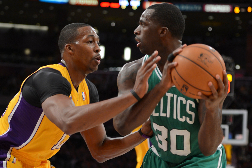 . Lakers Dwight Howard defends against Celtics\' Brandon Bass during first half action at Staples Wednesday. (David Crane/L.A. Daily News)