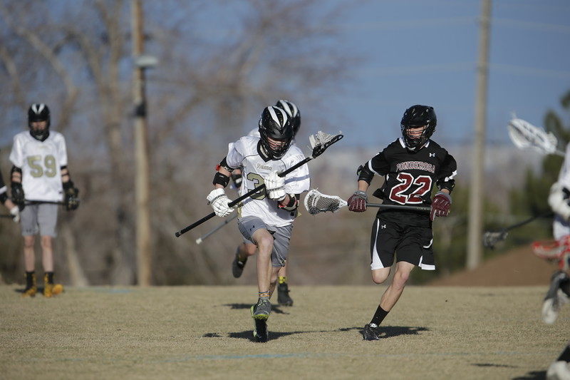 JPM0061-JPM0061-Jonathan first HS lacrosse game March 9th.jpg