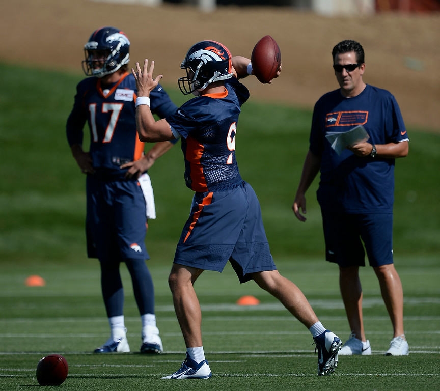 . Denver Broncos quarterback Bryn Renner (9) throws a pass during the first day of the Denver Broncos 2014 training camp July 24, 2014 at Dove Valley. (Photo by John Leyba/The Denver Post)