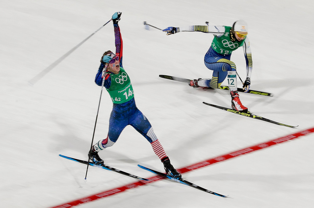 . Jessica Diggins, left, of the United States, celebrates after winning the gold medal past Stina Nilsson, of Sweden, in the during women\'s team sprint freestyle cross-country skiing final at the 2018 Winter Olympics in Pyeongchang, South Korea, Wednesday, Feb. 21, 2018. (AP Photo/Dmitri Lovetsky)