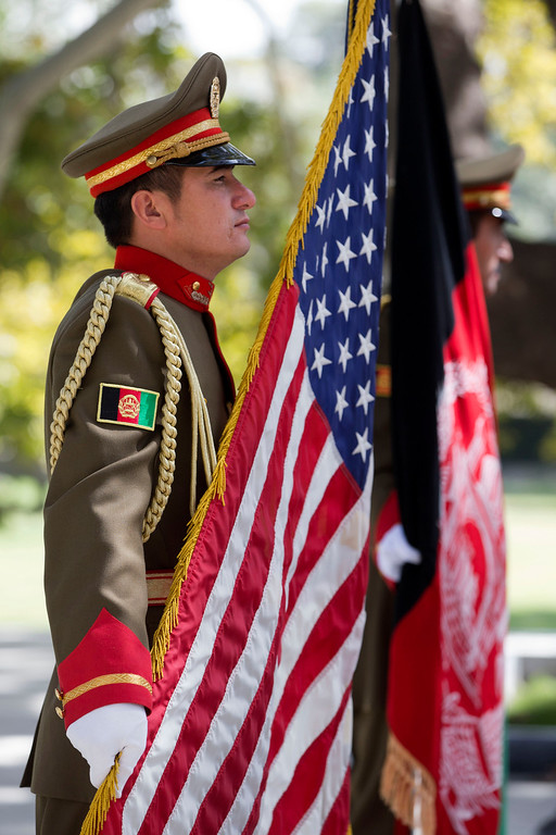 . Afghan honor guard soldiers hold straight a U.S. and Afghan flag in preparation for an expected and delayed news conference between U.S. Secretary of State John Kerry and Afghan President Hamid Karzai at the Presidential Palace during an unannounced stop in Kabul, Afghanistan, on Saturday, Oct. 12, 2013, as a deadline approaches for a security deal about the future of U.S. troops in the country. (AP Photo/Jacquelyn Martin, Pool)