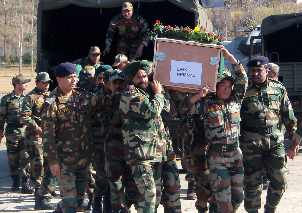 Description of . Indian army personnel carry the coffin of soldier Lance Naik Hemraj at Rajouri, some 148 kms from state winter capital Jammu on January 9, 2013 where a post-mortem will be conducted at the army hospital to confirm the extent of injuries.  India summoned Pakistan\'s envoy in New Delhi Wednesday to protest the killing of two soldiers in a border clash, but warned against any escalation, after apparent tit-for-tat skirmishes that have led to deaths on both sides.  Two Indian soldiers died after a firefight erupted in disputed Kashmir on Tuesday as a patrol moving in fog discovered Pakistani troops about 500 metres (yards) inside Indian territory, according to the Indian army.   AFP PHOTOSTR/AFP/Getty Images